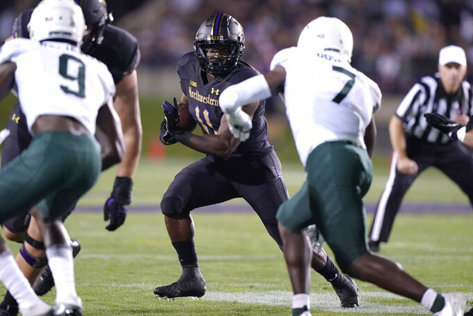 Northwestern running back Andrew Clair (11) carries against Michigan State during the first half of an NCAA college football game in Evanston, Ill., Friday, Sept. 3, 2021. (AP Photo/Nam Y. Huh)