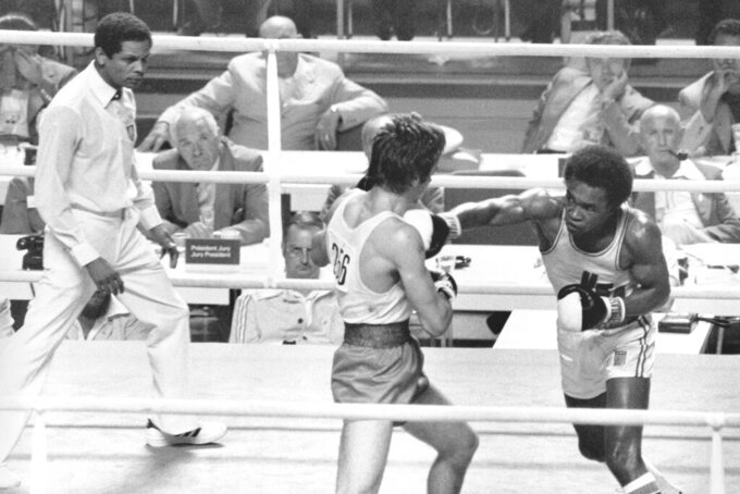FILE - In this July 29, 1976, file photo, the United States' Sugar Ray Leonard, right, throws a right at Kazmier Szczerba, of Poland, during the light welterweight boxing match at the Summer Olympic Games in Montreal. (AP Photo/File)