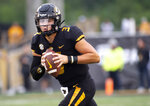 FILE - In this Saturday, Sept. 8, 2018, file photo, Missouri quarterback Drew Lock warms up before an NCAA college football game against Wyoming in Columbia, Mo. Georgia's stifling defense will face its toughest challenge so far in trying to stop quarterback Drew Lock and the Missouri Tigers on Saturday.  (AP Photo/L.G. Patterson, File)