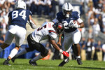 Penn State running back Keyvone Lee (24) looks to elude Ball State safety Bryce Cosby (5) during an NCAA college football game in State College, Pa., Saturday, Sept. 11, 2021. (AP Photo/Barry Reeger)