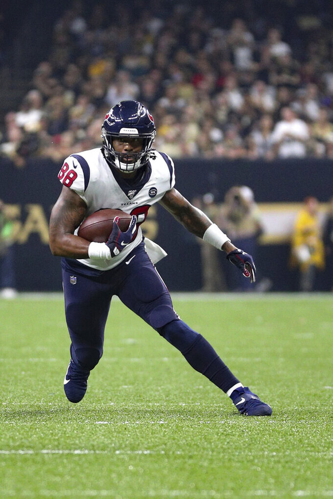 Houston Texans tight end Jordan Akins (88) gains yardage after catching the ball in an NFL game against the New Orleans Saints, Monday, Sept. 9, 2019, in New Orleans. The Saints defeated the Texans 30-28. (Margaret Bowles via AP)