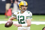 Green Bay Packers quarterback Aaron Rodgers throws during the first half of an NFL football game against the Houston Texans Sunday, Oct. 25, 2020, in Houston. (AP Photo/Sam Craft)