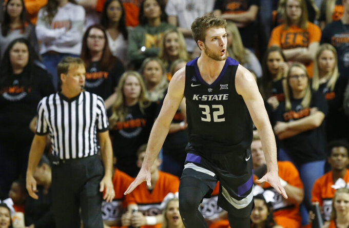 Kansas State forward Dean Wade celebrates after a dunk during the second half of the team's NCAA college basketball game against Oklahoma State in Stillwater, Okla., Saturday, Feb. 2, 2019. (AP Photo/Sue Ogrocki)