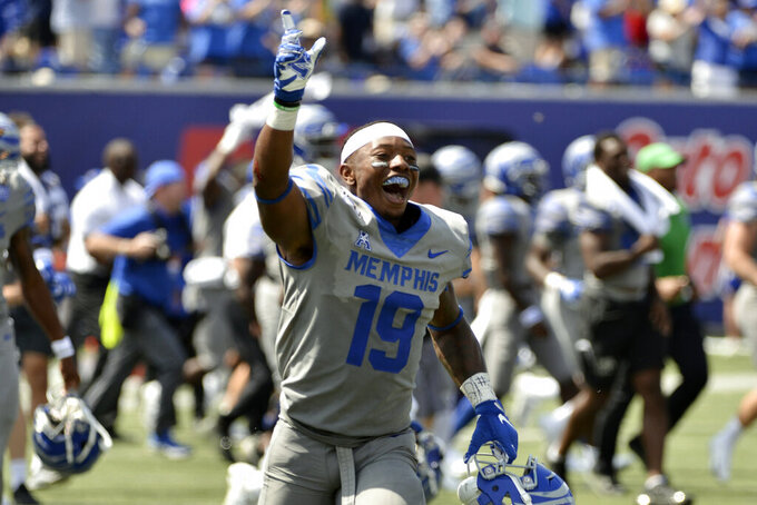Memphis running back Kenneth Gainwell (19) celebrates after winning an NCAA college football game against Mississippi Saturday, Aug. 31, 2019, in Memphis, Tenn. (AP Photo/Brandon Dill)