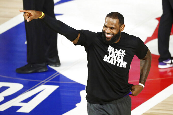 Los Angeles Lakers forward LeBron James (23) warms up before a NBA basketball game against the Indiana Pacers, Saturday, Aug. 8, 2020, in Lake Buena Vista, Fla. (Kim Klement/Pool Photo via AP)