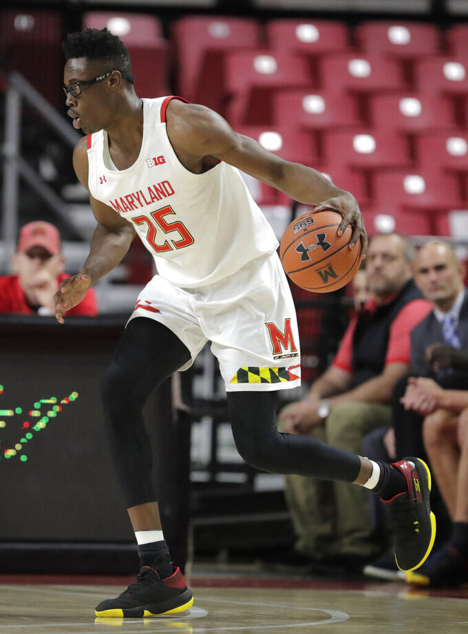 Maryland forward Jalen Smith drives against Holy Cross during the second half of an NCAA college basketball game, Tuesday, Nov. 5, 2019, in College Park, Md. Maryland won 95-71. (AP Photo/Julio Cortez)