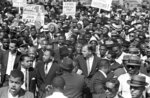FILE - In this June 23, 1963, file photo, theRev. Martin Luther King joins Detroit's Freedom March. During the critical era of the 1950s and '60s, King, who led the 250,000-strong March on Washington in 1963, and Malcolm X were colossal 20th century figures, representing two different tracks: mass non-violent protest and getting favorable outcomes