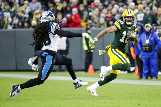 Green Bay Packers' Jake Kumerow tries to get past Carolina Panthers' Tre Boston during the first half of an NFL football game Sunday, Nov. 10, 2019, in Green Bay, Wis. (AP Photo/Mike Roemer)