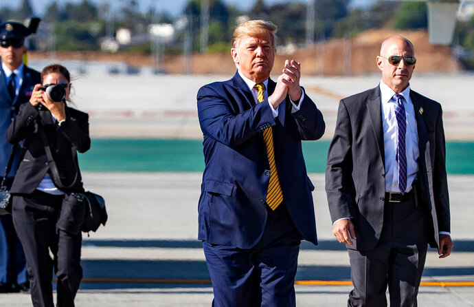 President Donald Trump walks toward supporters after arriving at Los Angeles International Airport on Air Force One, Tuesday, Sept. 17, 2019, in Los Angeles. (Gina Ferazzi/Los Angeles Times via AP)