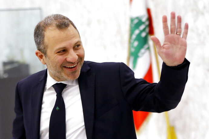 FILE - This Feb. 2, 2019 file photo, Lebanese Foreign Minister Gebran Bassil arrives to attend the first meeting of the Lebanese cabinet at the Presidential Palace in Baabda, east of Beirut, Lebanon. Lebanese are campaigning against the participation of their acting foreign minister in the prestigious World Economic Forum in Davos, saying Bassil, who was the target of popular anger in the ongoing nationwide protests,  should not represent them on the international stage. (AP Photo/Bilal Hussein, File)