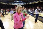 Iowa head coach Lisa Bluder celebrates as she walks off the court after an NCAA college basketball game against Maryland, Sunday, Feb. 17, 2019, in Iowa City, Iowa. (AP Photo/Charlie Neibergall)