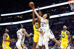 New Orleans Pelicans center Jaxson Hayes (10) reaches for the ball in front of Pelicans guard E'Twaun Moore (55) and Golden State Warriors forward Omari Spellman (4) in the first half of an NBA basketball game in New Orleans, Sunday, Nov. 17, 2019. (AP Photo/Tyler Kaufman)