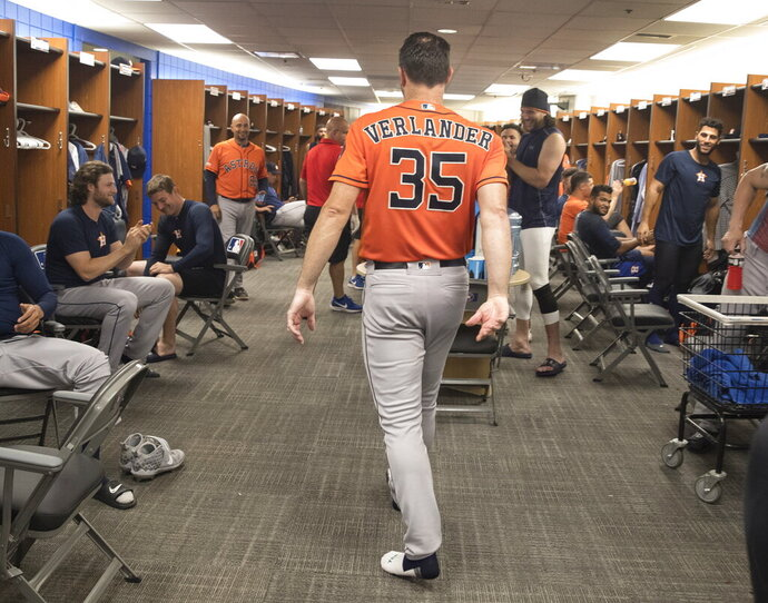Houston Astros starter Justin Verlander walks through the clubhouse after pitching a no-hitter against the Toronto Blue Jays in a baseball game in Toronto, Sunday, Sept. 1, 2019. (Fred Thornhill/The Canadian Press via AP)