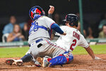 Cleveland Indians' Yu Chang, right, scores as Texas Rangers' Jose Trevino is late with the tag during the sixth inning of a baseball game Wednesday, Aug. 25, 2021, in Cleveland. (AP Photo/Tony Dejak)