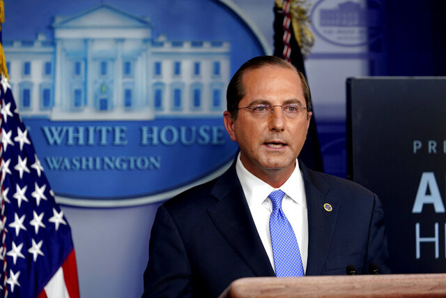 FILE - In this Friday, Nov. 20, 2020 file photo, Health and Human Services Secretary Alex Azar speaks during a news conference in the briefing room at the White House in Washington. A federal judge in Maryland has denied the Trump administration's request to reinstate a rule that would require women to visit a hospital, clinic or medical office to obtain an abortion pill during the COVID-19 pandemic, noting that public health risks for patients only have grown worse. In March, dozens of anti-abortion advocates signed a letter to Azar in which they called for halting abortion procedures during the pandemic. (AP Photo/Susan Walsh, File)
