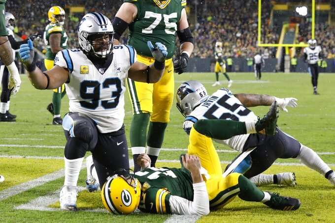 Carolina Panthers' Gerald McCoy reacts after being called for a roughing the passer penalty after hitting Green Bay Packers' Aaron Rodgers during the first half of an NFL football game Sunday, Nov. 10, 2019, in Green Bay, Wis. (AP Photo/Mike Roemer)