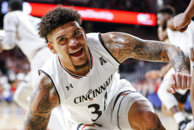 Cincinnati's Jarron Cumberland reacts after scoring in the first half of the team's NCAA college basketball game against South Florida, Tuesday, Jan. 15, 2019, in Cincinnati. (AP Photo/John Minchillo)