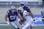 Oklahoma State quarterback Spencer Sanders (3) scrambles away from Kansas State defensive ends Wyatt Hubert (56) and Khalid Duke (29) during the first half of an NCAA college football game in Manhattan, Kan., Saturday, Nov. 7, 2020. (AP Photo/Orlin Wagner)