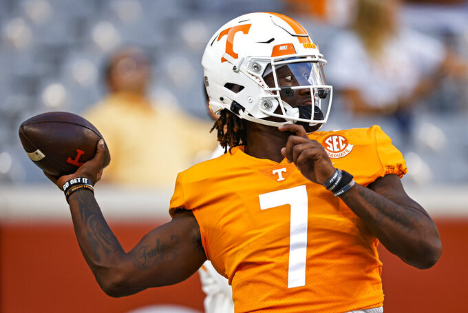Tennessee quarterback Joe Milton III warms up for the team's NCAA college football game against Bowling Green on Thursday, Sept. 2, 2021, in Knoxville, Tenn. (AP Photo/Wade Payne)