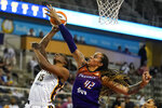Phoenix Mercury center Brittney Griner (42) blocks the shot of Indiana Fever forward Teaira McCowan (15) in the second half of a WNBA basketball game in Indianapolis, Monday, Sept. 6, 2021. (AP Photo/Michael Conroy)
