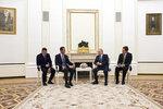 Russian President Vladimir Putin, second right, speaks to Syrian President Bashar Assad during their meeting in the Kremlin in Moscow, Russia, Monday, Sept. 13, 2021. (Mikhail Klimentyev, Sputnik, Kremlin Pool Photo via AP)