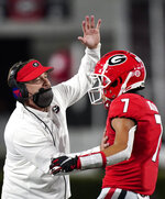 FILE - In this Saturday, Oct. 3, 2020, file photo, Georgia coach Kirby Smart congratulates wide receiver Jermaine Burton (7) after he scored a touchdown during the first half of the team's NCAA college football game against Auburn, in Athens, Ga. mart is proud of the resiliency demonstrated by his No. 3 Bulldogs in winning twice after trailing at halftime. As Georgia prepares to play at No. 2 Alabama, Smart just wishes Georgia would enjoy better starts and avoid those early deficits. (AP Photo/Brynn Anderson, File)