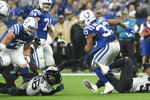 Indianapolis Colts running back Jonathan Williams (33) runs out of a tackle by Jacksonville Jaguars' Ronnie Harrison (36) during the first half of an NFL football game, Sunday, Nov. 17, 2019, in Indianapolis. (AP Photo/AJ Mast)