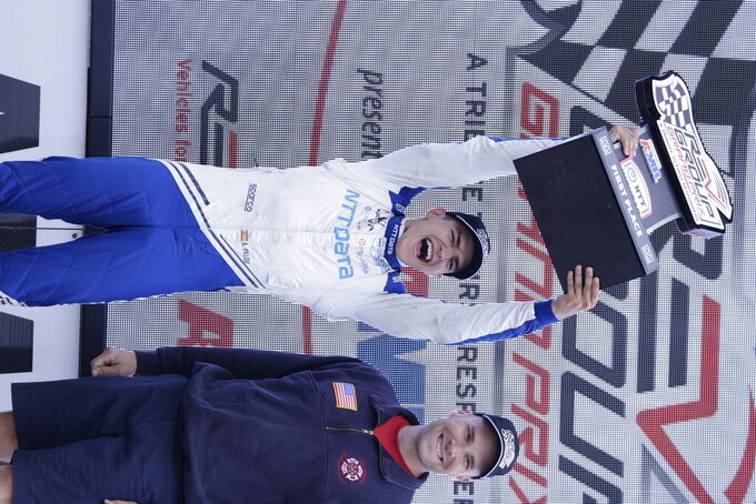 Alex Palou, left, celebrates after winning an IndyCar race at Road America in Elkhart Lake, Wisc., Sunday, June 20, 2021. (AP Photo/Jeffrey Phelps)