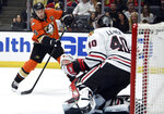 Anaheim Ducks center Ryan Getzlaf, left, attempts a shot while Chicago Blackhawks goalie Robin Lehner guards the goal during the second period of an NHL hockey game in Anaheim, Calif., Sunday, Nov. 3, 2019. (AP Photo/Kelvin Kuo)