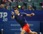 Hubert Hurkacz, of Poland, hits a forehand to Benoit Paire, of France, in the championship match of the Winston-Salem Open tennis tournament in Winston-Salem, N.C., Saturday, Aug. 24, 2019. Hurkacz won 6-3, 3-6, 6-3. (AP Photo/Nell Redmond)