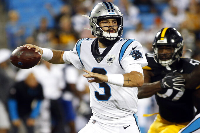 FIEL- In this Aug. 29, 2019, file photo, Carolina Panthers quarterback Will Grier (3) rolls out to pass during the first half of an NFL preseason football game against the Pittsburgh Steelers in Charlotte, N.C. Panthers interim coach Perry Fewell has announced that Grier will start Sunday's game at Indianapolis.(AP Photo/Brian Blanco, File)