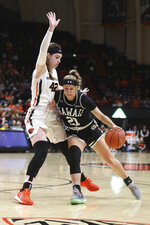 Hawaii's Kasey Neubert (21) tries to get around Oregon State's Kennedy Brown (42) during the first half of an NCAA college basketball game in Corvallis, Ore., Friday, Dec. 6, 2019. (AP Photo/Amanda Loman)