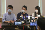 Pro-democracy activists, from left; Joshua Wong, Nathan Law and Agnes Chow attend a press conference in Hong Kong, Saturday, May 30, 2020. President Donald Trump has announced a series of measures aimed at China as a rift between the two countries grows. He said Friday that he would withdraw funding from the World Health Organization, end Hong Kong's special trade status and suspend visas of Chinese graduate students suspected of conducting research on behalf of their government. (AP Photo/Kin Cheung)