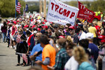 People line the side of the road waiting for the motorcade with President Donald Trump to drive past on Thursday, May 14, 2020, in Allentown, Pa. (AP Photo/Matt Rourke)