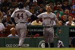 Houston Astros' Carlos Correa, right, greets Yordan Alvarez, left, at the dugout after his home run against the Boston Red Sox during the fourth inning of a baseball game Tuesday, June 8, 2021, at Fenway Park in Boston. (AP Photo/Winslow Townson)