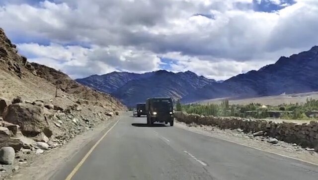This frame grab from video shows an Indian army convoy driving in Leh, India. India and China accused each other on Tuesday of making provocative military moves and firing warning shots along their disputed border despite talks on ending the escalating tensions. The nuclear-armed rivals have been engaged in a tense standoff in the cold-desert Ladakh region since May, and their defense ministers met Friday in Moscow in the first high-level direct contact between the sides since the standoff began. (AP Photo)