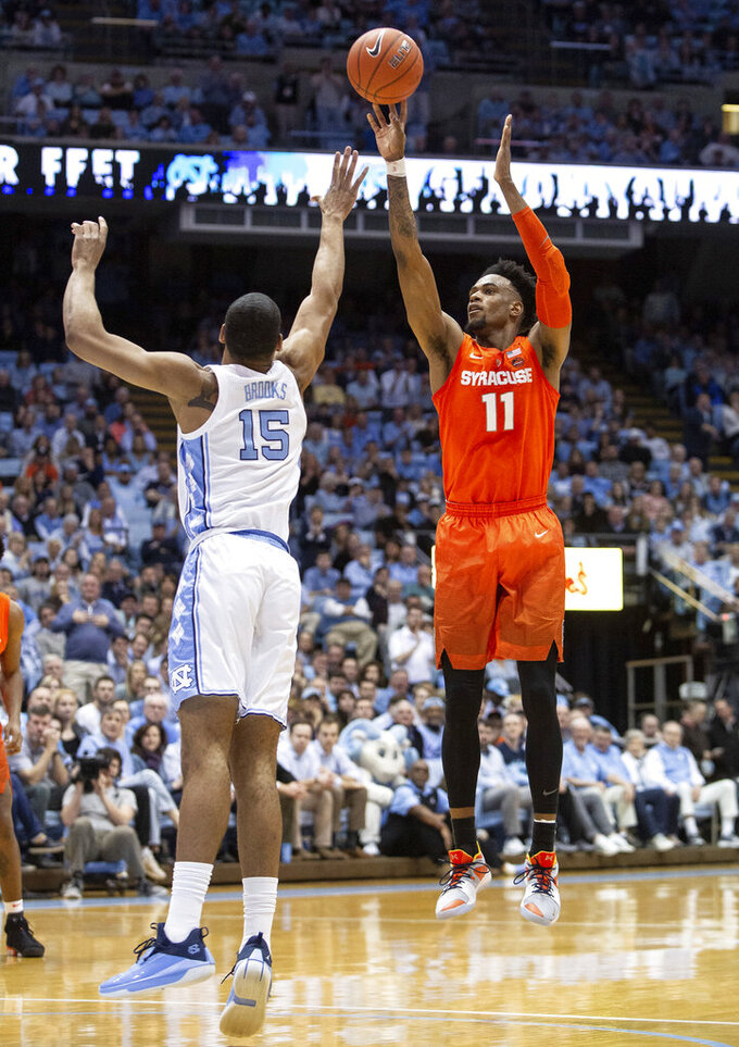 Syracuse's Oshae Brissett (11) shoots over North Carolina's Garrison Brooks (15) during the second half of an NCAA college basketball game in Chapel Hill, N.C., Tuesday, Feb. 26, 2019. (AP Photo/Ben McKeown)