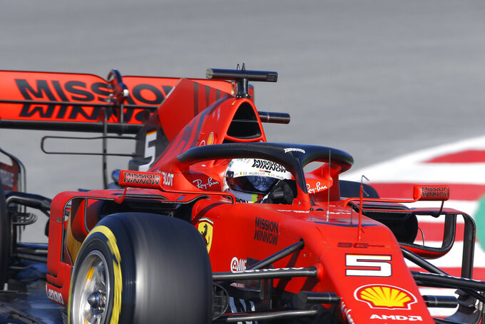 Ferrari driver Sebastian Vettel of Germany steers his car during a Formula One pre-season testing session at the Barcelona Catalunya racetrack in Montmelo, outside Barcelona, Spain, Wednesday, Feb. 27, 2019. (AP Photo/Joan Monfort)