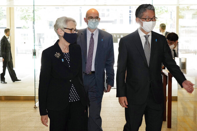 U.S. Deputy Secretary of State Wendy Sherman, left, is escorted by Japanese Vice-Minister for Foreign Affairs Takeo Mori, right, prior to their meeting at the Iikura Guesthouse Tuesday, July 20, 2021, in Tokyo. (AP Photo/Eugene Hoshiko, Pool)
