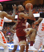 Boston College's Steffon Mitchell, center, drives to the basket during the second half of an NCAA college basketball game against Syracuse in Syracuse, N.Y., Saturday, Feb. 9, 2019. Syracuse won 67-56. (AP Photo/Nick Lisi)