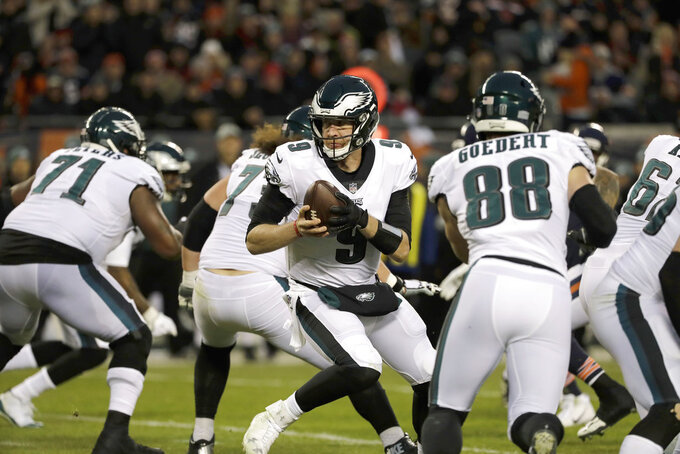 Philadelphia Eagles quarterback Nick Foles (9) looks to hand off the ball during the first half of an NFL wild-card playoff football game against the Chicago Bears Sunday, Jan. 6, 2019, in Chicago. (AP Photo/Nam Y. Huh)