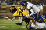 Minnesota running back Mohamed Ibrahim (24) is tackled by South Dakota State safeties Tyler DeMartra (38) and Joshua Manchigiah (3) during an NCAA college football game Thursday, Aug. 29, 2019, in Minneapolis. (AP Photo/Stacy Bengs)