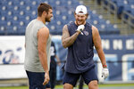 Tennessee Titans offensive tackle Taylor Lewan, right, talks with offensive tackle Jack Conklin before an NFL football game against the Buffalo Bills Sunday, Oct. 6, 2019, in Nashville, Tenn. Lewan is scheduled to play in the game after serving a four-game suspension after failing a drug test for a banned substance. (AP Photo/Mark Zaleski)
