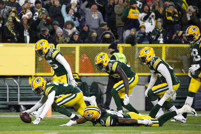 The Green Bay Packers defense celebrates after Tramon Williams intercepted a pass during the second half of an NFL football game against the Carolina Panthers Sunday, Nov. 10, 2019, in Green Bay, Wis. (AP Photo/Jeffrey Phelps)