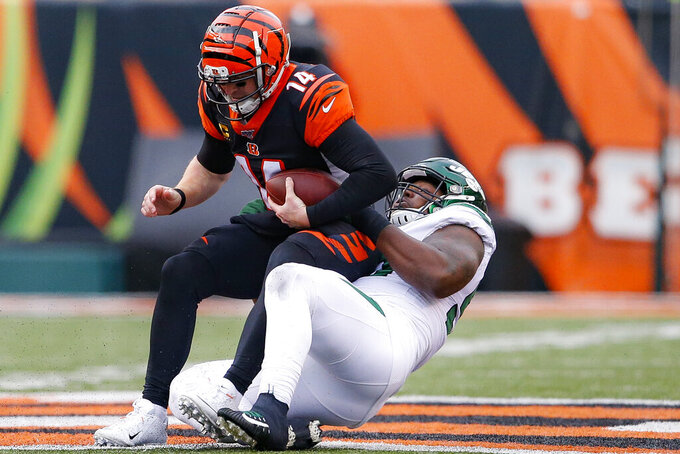Cincinnati Bengals quarterback Andy Dalton (14) is sacked New York Jets nose tackle Steve McLendon (99) during the second half of an NFL football game, Sunday, Dec. 1, 2019, in Cincinnati. (AP Photo/Gary Landers)