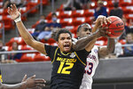 Missouri guard Dru Smith (12) and Auburn forward Jaylin Williams (23) reach for a rebound during the first half of an NCAA college basketball game Tuesday, Jan. 26, 2021, in Auburn, Ala. (AP Photo/Julie Bennett)