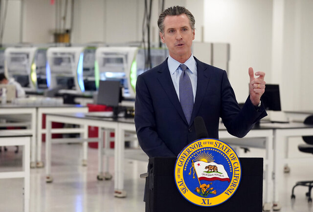 FILE - In this Oct. 30, 2020, file photo, California Gov. Gavin Newsom speaks at a COVID-19 testing facility in Valencia, Calif. As California Gov. Gavin Newsom weighs whom to appoint to the Senate to fulfill the rest of Vice President-elect Kamala Harris' term, he's facing pressure to name a Latino or a Black woman. (AP Photo/Marcio Jose Sanchez, Pool, File)