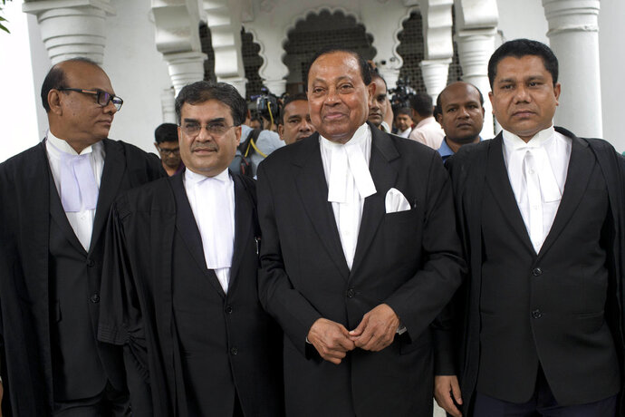 Lawyer supporting opposition Bangladesh Nationalist Party (BNP) leave the Supreme Court after the court upheld a High Court's decision to grant bail to opposition leader and former Prime Minister Khaleda Zia in Dhaka, Bangladesh, Wednesday, May 16, 2018. Zia, was jailed for five years on a corruption conviction. (AP Photo/A. M. Ahad)