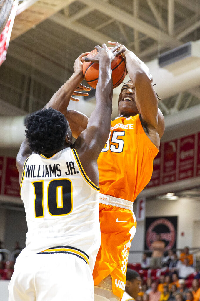 Virginia Commonwealth guard Vince Williams (10) blocks the shot of Tennessee guard Yves Pons (35) during the second half of an NCAA college basketball game at the Emerald Coast Classic in Niceville, Fla., Saturday, Nov. 30, 2019. Tennessee won 72-69. (AP Photo/Mark Wallheiser)