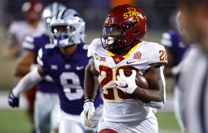 Iowa State running back Breece Hall (28) rushes for a first down as he is chased by Kansas State defenders during the fourth quarter of an NCAA college football game on Saturday, Oct. 16, 2021, in Manhattan, Kan. (AP Photo/Colin E. Braley)